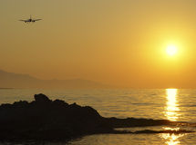 Flying to sunset. Greece, Crete. The plane landed at the ongoing sun rays Royalty Free Stock Photography