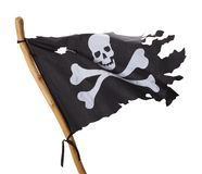 Pirate Flag. Flying Torn Pirate Flag Isolated on White Background royalty free stock photo