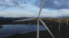 Flying towards windmills stock video footage