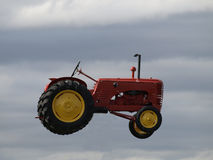 Flying tractor. Royalty Free Stock Photos