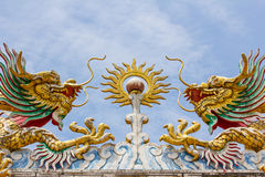Flying twin golden dragons with the ball Royalty Free Stock Images
