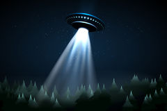 Flying UFO over night forest Royalty Free Stock Image