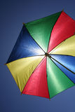 Flying umbrella Stock Image