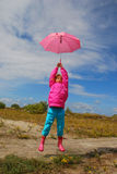 Flying with umbrella Stock Images