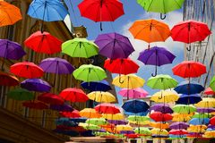 Flying umbrella on the street Stock Image