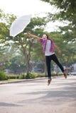 Flying with umbrella Stock Photo