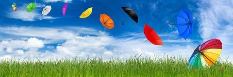 Flying umbrellas Stock Photo