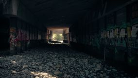 Flying Under Industrial Bridge With Graffiti. Aerial shot flying through an area under the bridge with graffiti stock footage