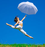Flying under umbrella Royalty Free Stock Image