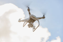 Flying unmanned quadcopter with video camera.  Royalty Free Stock Photo