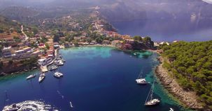 Flying up above Assos village in Kefalonia stock video footage