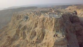 Flying up at ancient remains of masada. Copter flying up at ancient remains of masada stock video footage