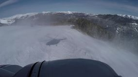 Flying up the helicopter in the snowy mountains stock video