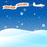Flying vintage plane with banner and snowy hills, winter scene. Royalty Free Stock Photo