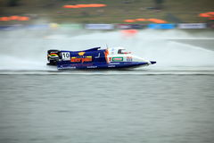 Flying on the water. Portugal Duarte Benavente from F1 Atlantic Team was flying on the final race at GP of China. His powerboat positioned 11 at the race. F1H20 Royalty Free Stock Photos