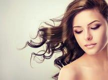 Flying wavy, dense hair. Close up portrait. Royalty Free Stock Photo