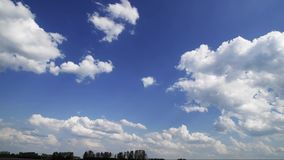 Flying white clouds in summer stock footage