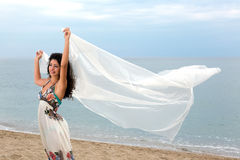 Flying white scarf on beach Stock Photography