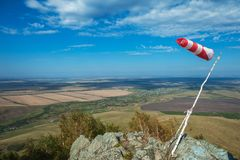 Flying windsock wind vane. On mountine backgound, Check wind speed for paragliding in mountains stock image