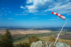 Flying windsock wind vane. On mountine backgound, Check wind speed for paragliding in mountains stock photos