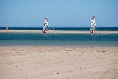 Fuerteventura, windsurf school at Sotavento beach lagoon.. Flying windsurfers at Sotavento beach lagoon. Fuerteventura - Canary Islands Stock Image