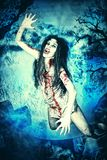 Flying witch. Bloodthirsty vampire flying at the night cemetery in the mist and moonlight Royalty Free Stock Photo