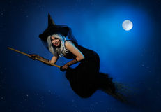 Flying witch with a broom Stock Image