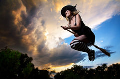 Flying witch on broomstick. In the evening Royalty Free Stock Photos