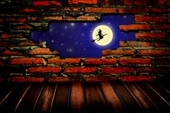 Flying witch at night through the hole in the bric Royalty Free Stock Images