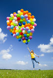 Flying With Balloons Royalty Free Stock Image