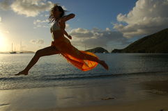 Flying woman. Woman flying over beach Royalty Free Stock Photos