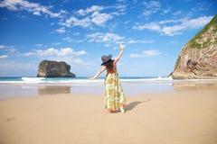 Flying woman in Ballota beach Stock Photography