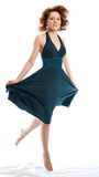 The flying woman in a dress. Studio shoot on white background Royalty Free Stock Photo