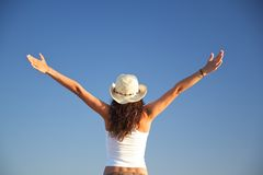 Flying woman with hat Royalty Free Stock Photo