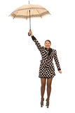 Flying woman with umbrella Royalty Free Stock Photos