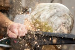 Flying wooden sawdust shavings while creating timber bowl royalty free stock images