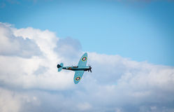 Flying WW2 spitfire aircraft Royalty Free Stock Image