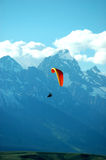 Flying wyoming. Powered paraglider in turn with Grand Teton in background Royalty Free Stock Image
