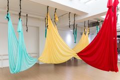 Flying yoga studio in break time with tied hammocks together at the yoga studio in Bangkok, Thailand stock photos
