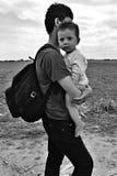Flyktingar i Sid (serben - den Croatina gränsen) Arkivfoto