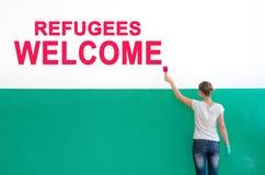 Flyktingvälkomnande Arkivbild