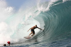 Flynn Novak at Pipeline. Flynn Novak is from the North Share of Hawaii and knows how to get the best waves out at Pipeline Royalty Free Stock Photos
