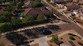 Flyover Establishing Shot Typical Arizona Neighborhood as Vehicle Leaves Driveway