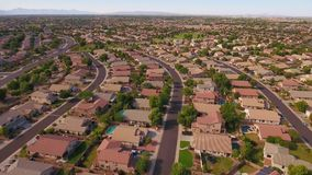 Flyover establishing shot typical Arizona Neighborhood