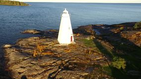 Aerial View Flyover on Historic White Lighthouse - Drone Video stock video