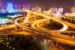 Flyover in modern city at night Stock Images