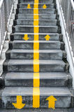 Flyover stairs with up and down yellow arrows separated by line. Flyover stairs with up and down yellow arrows separated by line Royalty Free Stock Image