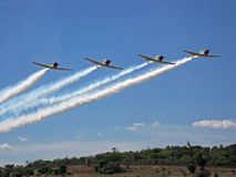 FLYPAST OF HARVARDS TRAILING SMOKE Stock Images