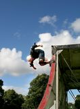 Flys like a butterfly. Skateboarder doing his thing at local Park Royalty Free Stock Photos