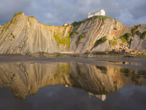 Flysch and Itzurun beach and San Telmo chapel , Zumaia. Stock Image